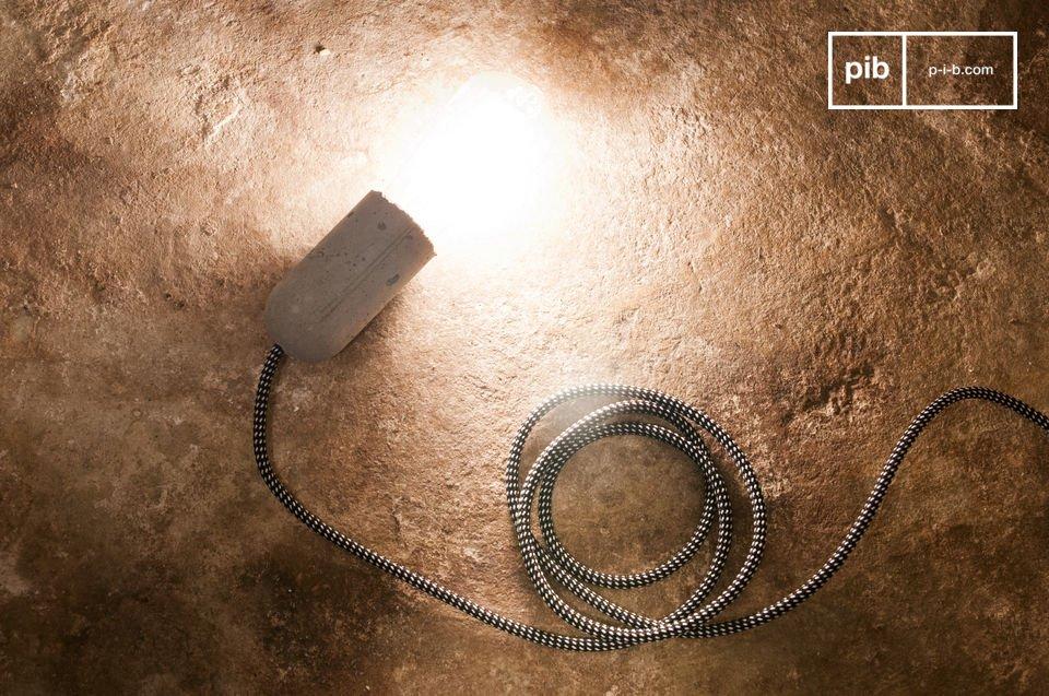 La lámpara colgante de cemento NUD puede colgarse del techo o envolverla alrededor de un objeto