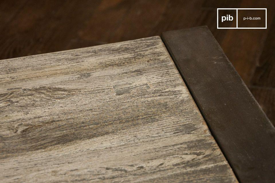 Mesa de centro gris diseñada con acero y madera noble
