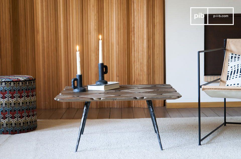 Esta inusual mesa de centro con sus estrechas patas biseladas aportará estilo y ligereza a un