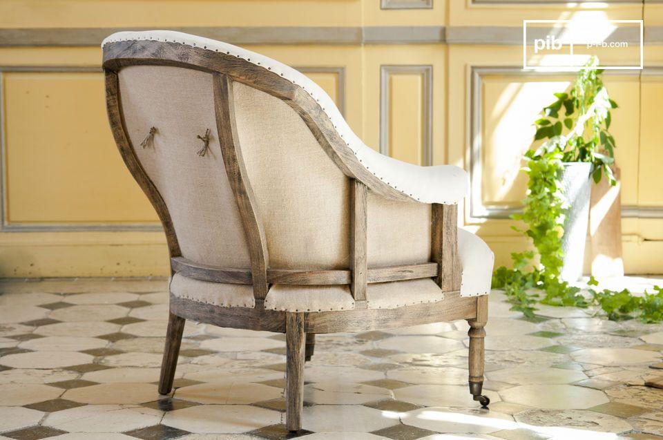 El sillón redondo Léonie es un hermoso sillón de tela blanca que le dará un toque elegante