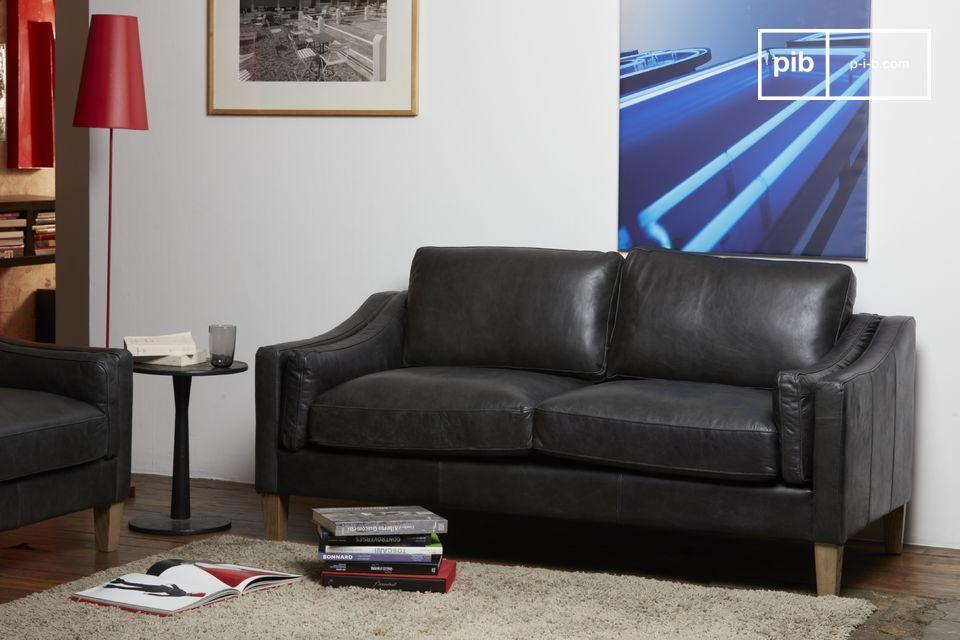 Hermoso sofá en cuero negro plena flor