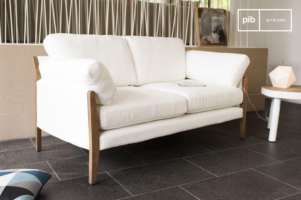 Este sofá se compone de una estructura de madera maciza de roble cuidadosamente barnizada