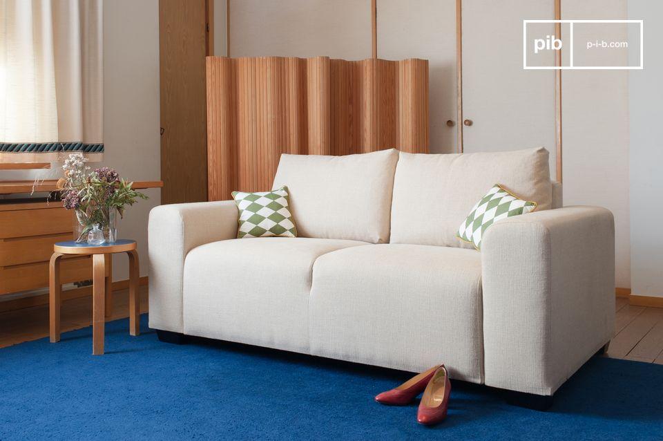 Un sofá de líneas sobrias inspirado en el art-deco, con un asiento cómodo